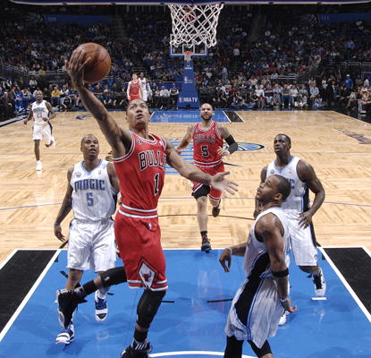 Derrick Rose goes up for a shot during a game in which he scores 24 points to lead the Bulls to a win over the Magic. (Getty Images)