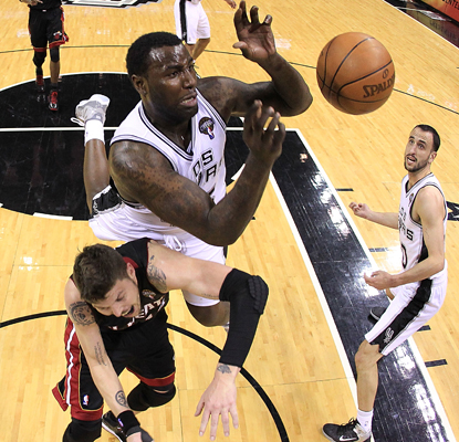 DeJuan Blair goes up over Mike Miller for one of his six rebounds in the Spurs' blowout win over the Heat. (Getty Images)