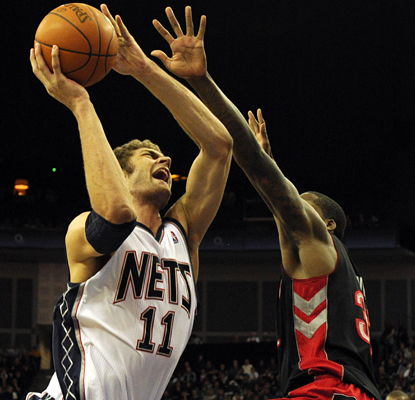 Ed Davis and the Raptors can't stop Brook Lopez from scoring 34 points and grabbing 14 rebounds in the Nets' win. (AP)
