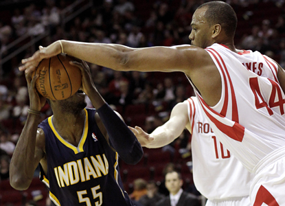 Houston's Chuck Hayes blocks a shot by Roy Hibbert and adds 10 rebounds in the Rockets' win over the Pacers. (AP)