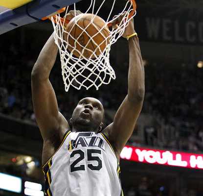 Al Jefferson dunks the ball off the fast break for two of his team-leading 27 points as the Jazz beat the Kings in overtime. (AP)