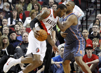 LaMarcus Aldridge drives past Boris Diaw and goes on to score 26 points in the Trail Blazers' win over the Bobcats. (AP)