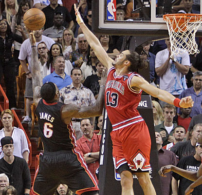 LeBron James gets this last-second shot over Chicago's Joakim Noah but can't get it to fall.  (AP)