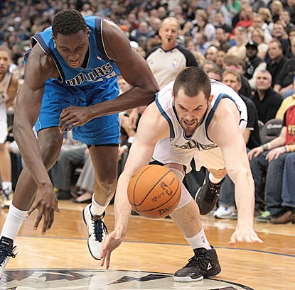 As usual, Kevin Love -- shown competing with Ian Mahinmi for a loose ball -- gives his all, but his efforts go for naught.  (Getty Images)
