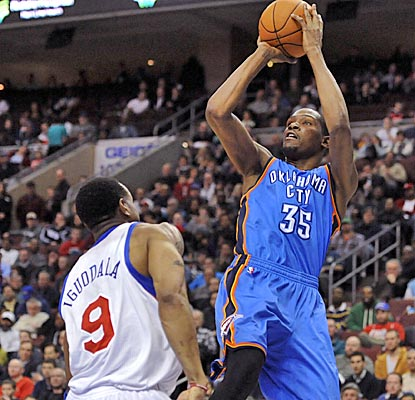 Kevin Durant shoots over 76ers guard Andre Iguodala, netting 34 and pulling down 16 boards in the overtime win. (US Presswire)