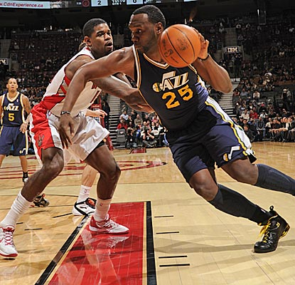 Al Jefferson drives against Amir Johnson, finishing with 34 points and the game-winning layup to rally the Jazz from 14 down. (Getty Images)