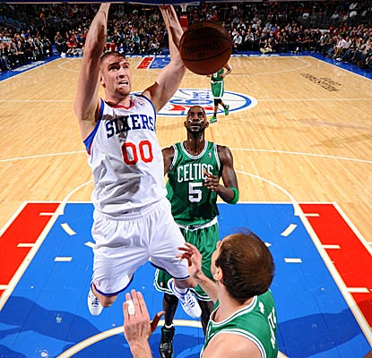 Spencer Hawes gets liftoff for the Sixers in their home win vs. the Celtics. (Getty Images)