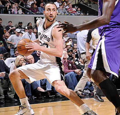 Manu Ginobili pulls Kings defenders toward the perimeter in the Spurs' home win. (Getty Images)