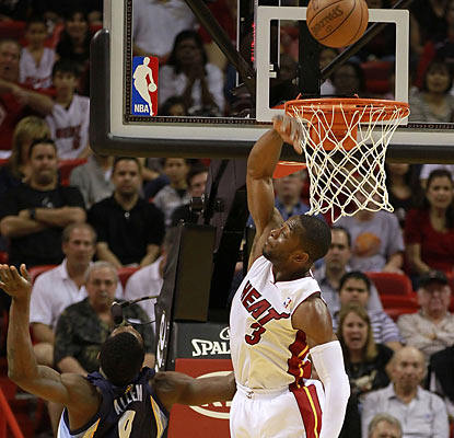 Dwyane Wade finishes with 28 points, nine assists, five boards and five blocks in Miami's 33-point rout over Memphis.  (Getty Images)
