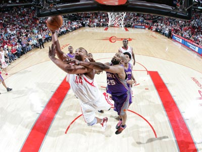 Chuck Hayes (44) posts a career-high 21 points and nine rebounds while helping the Rockets edge the Suns.  (Getty Images)