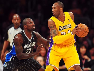 Playing with a sprained left ankle, Kobe Bryant scores 16 points during a win over the Magic.  (US Presswire)