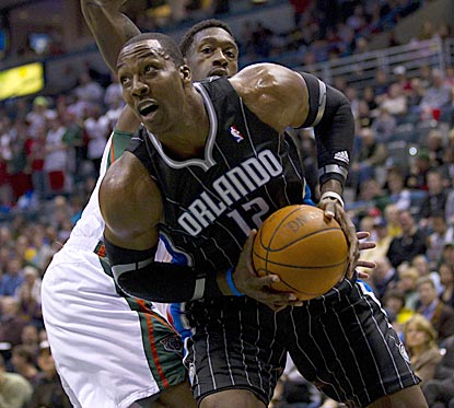 With Bucks center Andrew Bogut sidelined, Dwight Howard is too much for Larry Sanders (rear) and the Bucks to handle.  (US Presswire)