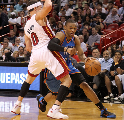 Russell Westbrook zips around Mike Bibby of the Heat as he works toward scoring 18 points in the Thunder's win. (Getty Images)