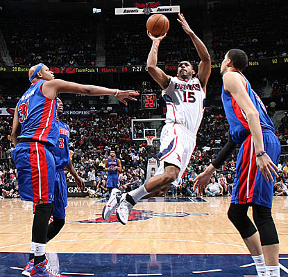 Hawks big man Al Horford gets off a shot vs. the Pistons, wrapping up with 18 points. (Getty Images)