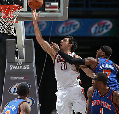 Carlos Delfino draws the and-one against the Knicks as the Bucks get a home win. (Getty Images)