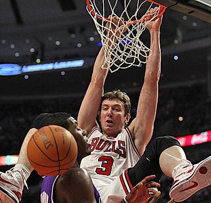 Omer Asik, one of eight Bulls to finish in double figures, throws down a dunk for two of his 15 points. (Getty Images)