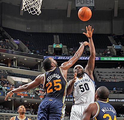 Zach Randolph drops in two of his 19 over Al Jefferson and adds 13 rebounds in a rout in Memphis. (Getty Images)