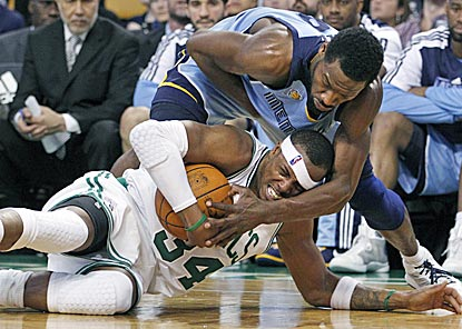 Paul Pierce and Tony Allen battle for a loose ball in the second half. The Celtics commit 18 turnovers in their loss.  (AP)
