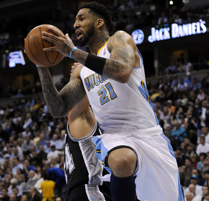 Nuggets forward Wilson Chandler goes up for a basket against the Spurs and later makes the go-ahead jump shot to win the game. (AP)