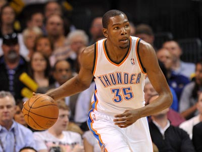 Kevin Durant scores 23 points while leading the Thunder to victory over the Love-less Wolves.  (Getty Images)