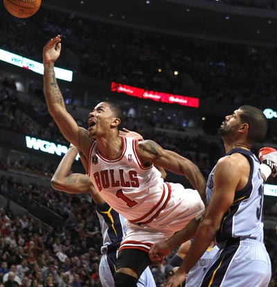 Derrick Rose scores 24 points, including two on this acrobatic layup leading to a critical three-point play down the stretch.  (Getty Images)