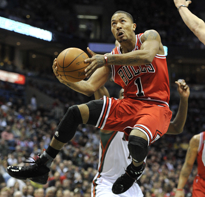 Derrick Rose scores 30 points, adds 17 assists and almost single-handedly leads the Bulls to a comeback win. (AP)