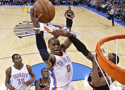 Russell Westbrook goes up for a basket and later hits three clutch 3-pointers in the Thunder's win over the Trail Blazers. (AP)