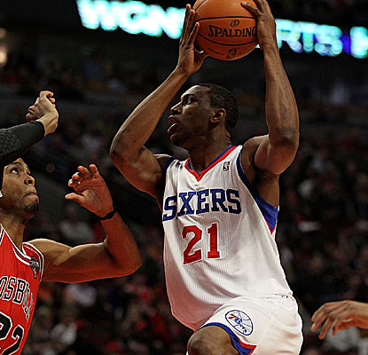 Thaddeus Young lifts off against a Bulls defender. The Philly forward leads six Sixers in double-digit scoring. (Getty Images)