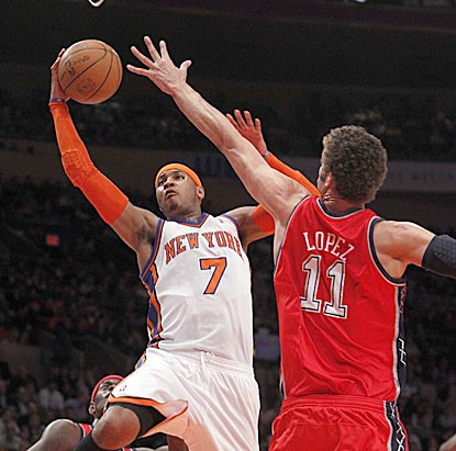 Carmelo Anthony takes it right to Brook Lopez in the first half. Anthony scores 36-plus points for the third consecutive game.  (US Presswire)