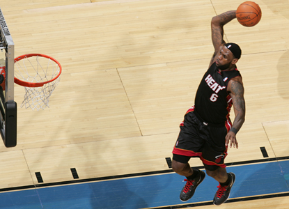 LeBron James soars in for the dunk as he leads the Heat with 35 points, eight rebounds and eight assists. (Getty Images)