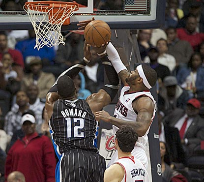 Josh Smith, shown rejecting a Dwight Howard shot in the second half, helps hold Howard to 17 points on 4-of-13 shooting.  (US Presswire)