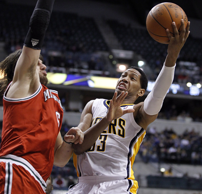 Danny Granger works around the Bucks defense and leads the Pacers with 17 points in an important win for No. 8 seed Indiana. (AP)