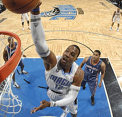 Dwight Howard throws down a dunk against the Bobcats, finishing with 26 points and 14 rebounds. (Getty Images)