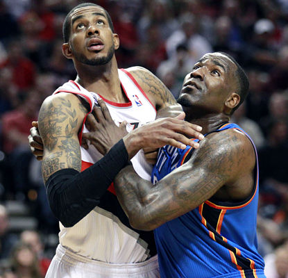 Kendrick Perkins (right) tries to tie up LaMarcus Aldridge but Aldridge manages to score 32 points in the Blazers' win. (AP)