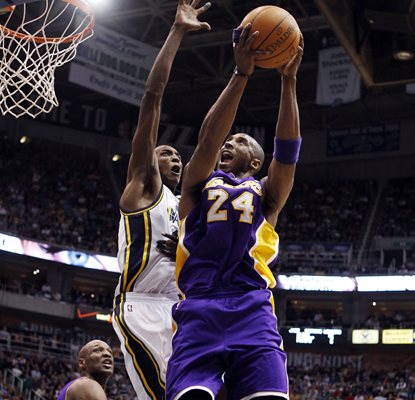 Kobe Bryant goes to the basket and scores 21 points in the Lakers' win over the Jazz, which eliminated Utah from the playoffs. (AP)