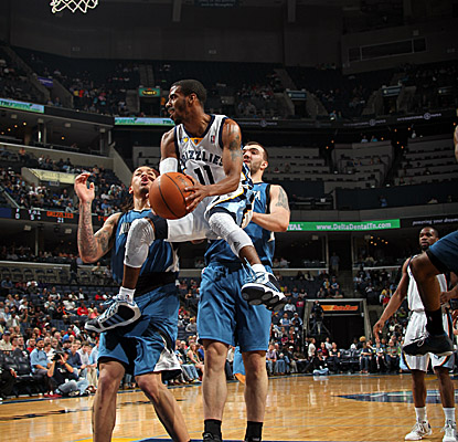 Grizzlies point guard Mike Conley looks to dish in the paint vs. the Wolves on Saturday. (Getty Images)