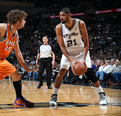 Tim Duncan looks for an opening against Suns center Robin Lopez on Sunday. (Getty Images)