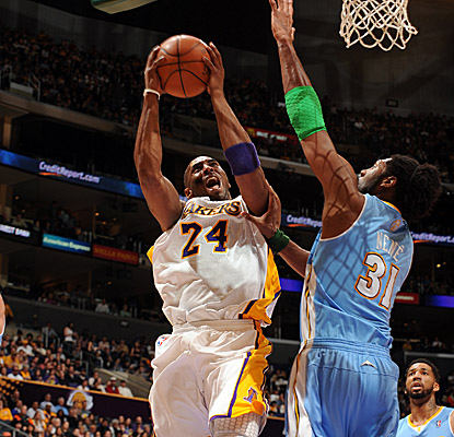 Kobe Bryant battles down low for a bucket, finishing with a game-high 28 points.  (Getty Images)