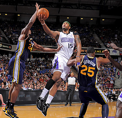 DeMarcus Cousins gets off a shot in the paint in the Kings' win over Utah. (Getty Images)