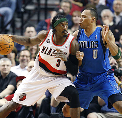 Gerald Wallace and the Blazers push Shawn Marion's Mavericks to the side as they win for the seventh time in the past 10 games. (AP)
