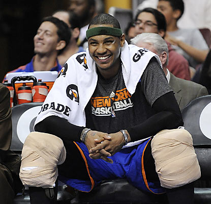 Carmelo Anthony (31 points, 11 rebounds) rests his body, but works his smile as his Knicks slide up to sixth slot in the East. (AP)
