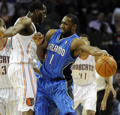 Gilbert Arenas runs into a defensive wall here, but leads the Magic with 25 points in an OT win.  (US Presswire)