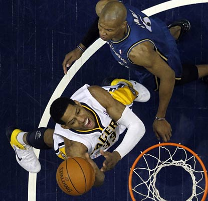 Danny Granger gets in close to score two of his team-high 25 points as the Pacers are returning to the postseason.  (AP)