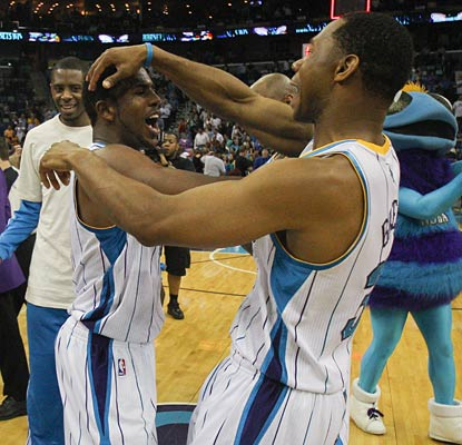 Chris Paul (left) and the Hornets are in a joyous mood after earning a third playoff berth in four seasons.  (US Presswire)