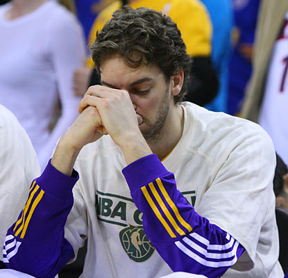 A somber Pau Gasol can hardly watch as his Lakers lose in straight nights and blow their chance at the top seed in the West.  (US Presswire)