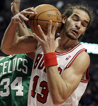 Chicago's Joakim Noah pulls down a rebound in front of Boston's Paul Pierce in the third. Noah, however, is held to two points. (AP)
