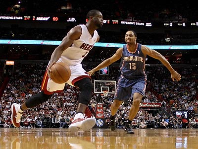 Dwyane Wade returns from a thigh injury and scores 27 points against the Bobcats. (Getty Images)