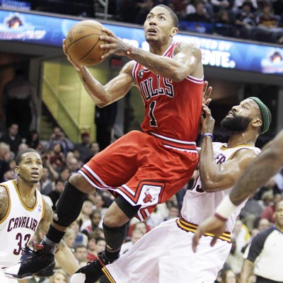 MVP front-runner Derrick Rose plays 33 minutes and scores 11 points against the Cavaliers. (AP)