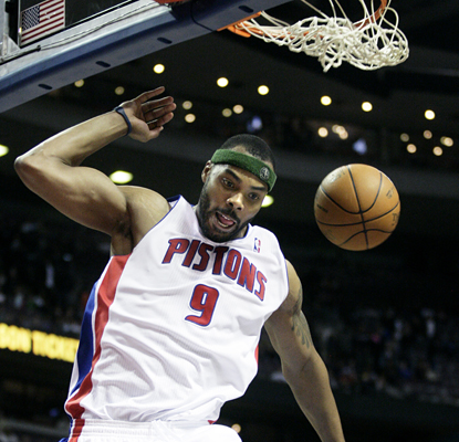 Chris Wilcox comes down from a dunk as he scores a season-high 27 points and adds 13 assists in the Pistons' win. (AP)
