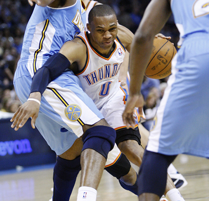 Russell Westbrook drives through the defense on his way to scoring 17 points as the Thunder top the Nuggets. (AP)